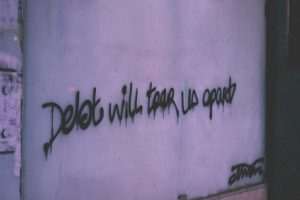 debt will tear us apart wall decor